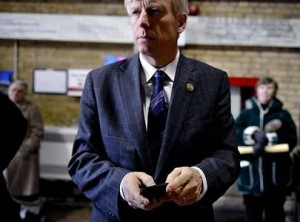 Mayor David Miller sends tweets out to his followers from his BlackBerry.