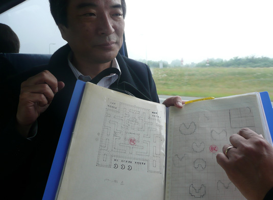 Pac-Man creator Tori Iwantani with the original design documents for the game.