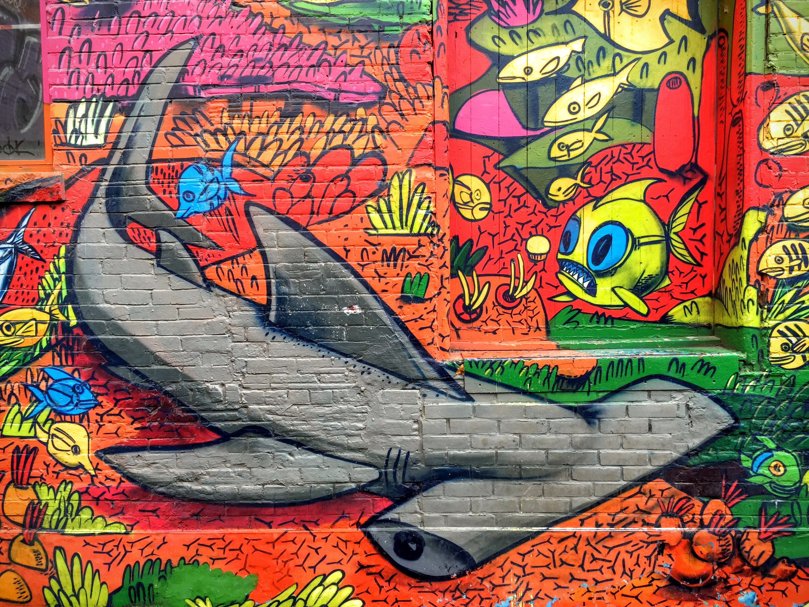 A photo of one of Toronto's iconic Graffiti Alley wall murals. Shot with the iPhone 6 Plus' stock rear-facing camera.