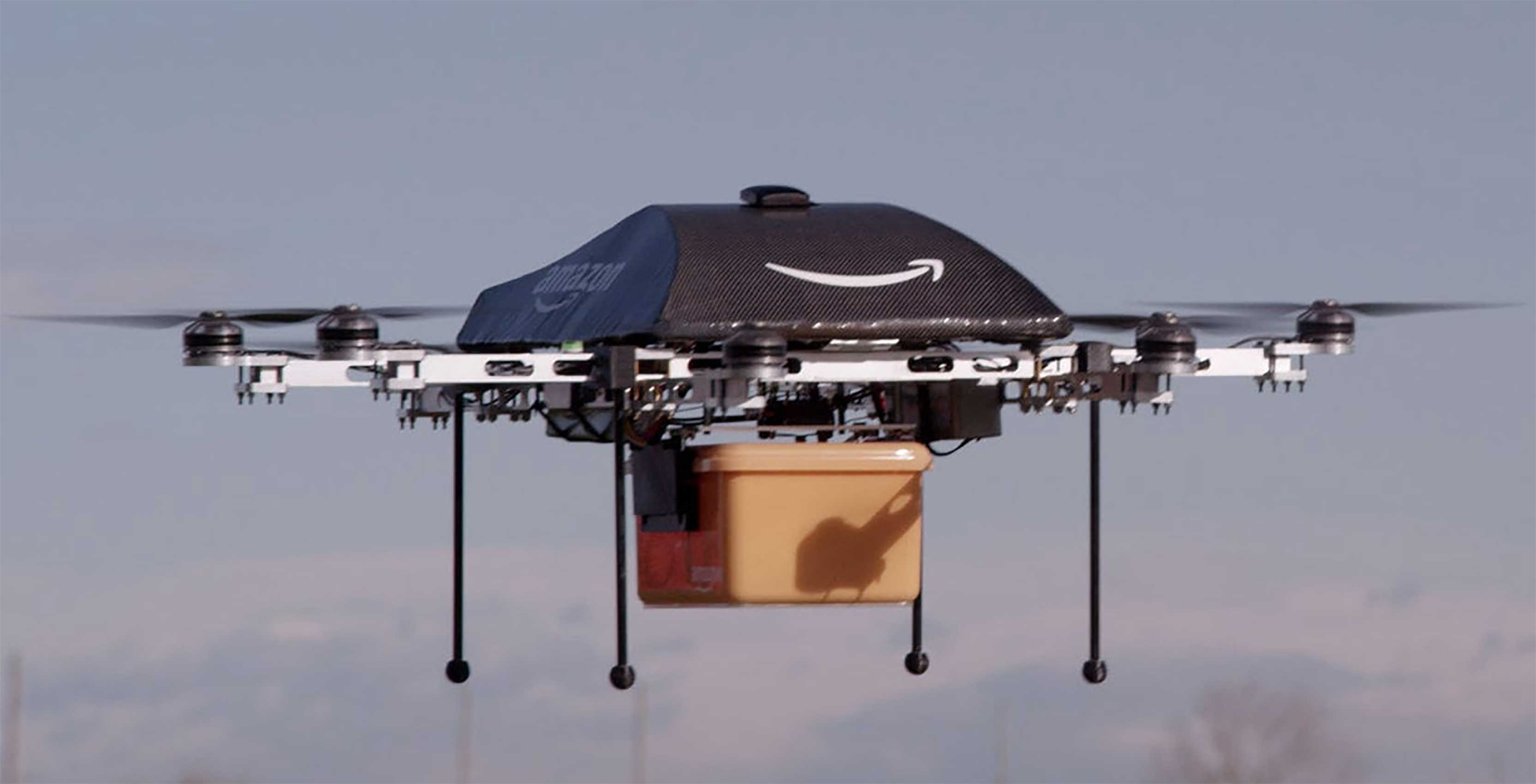 Amazon Drones deliver package while airborne
