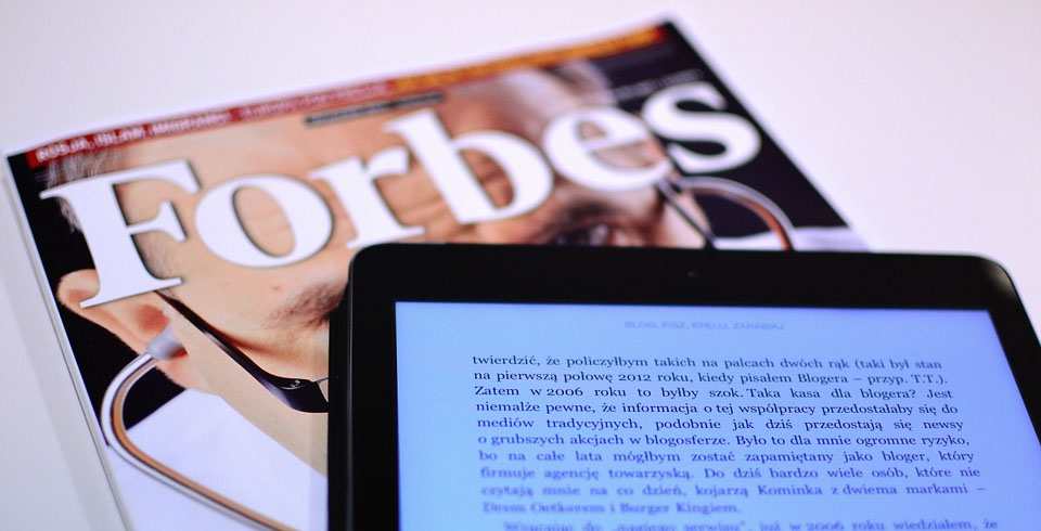 Forbes magazine with a tablet - Xplornet best employer in Canada