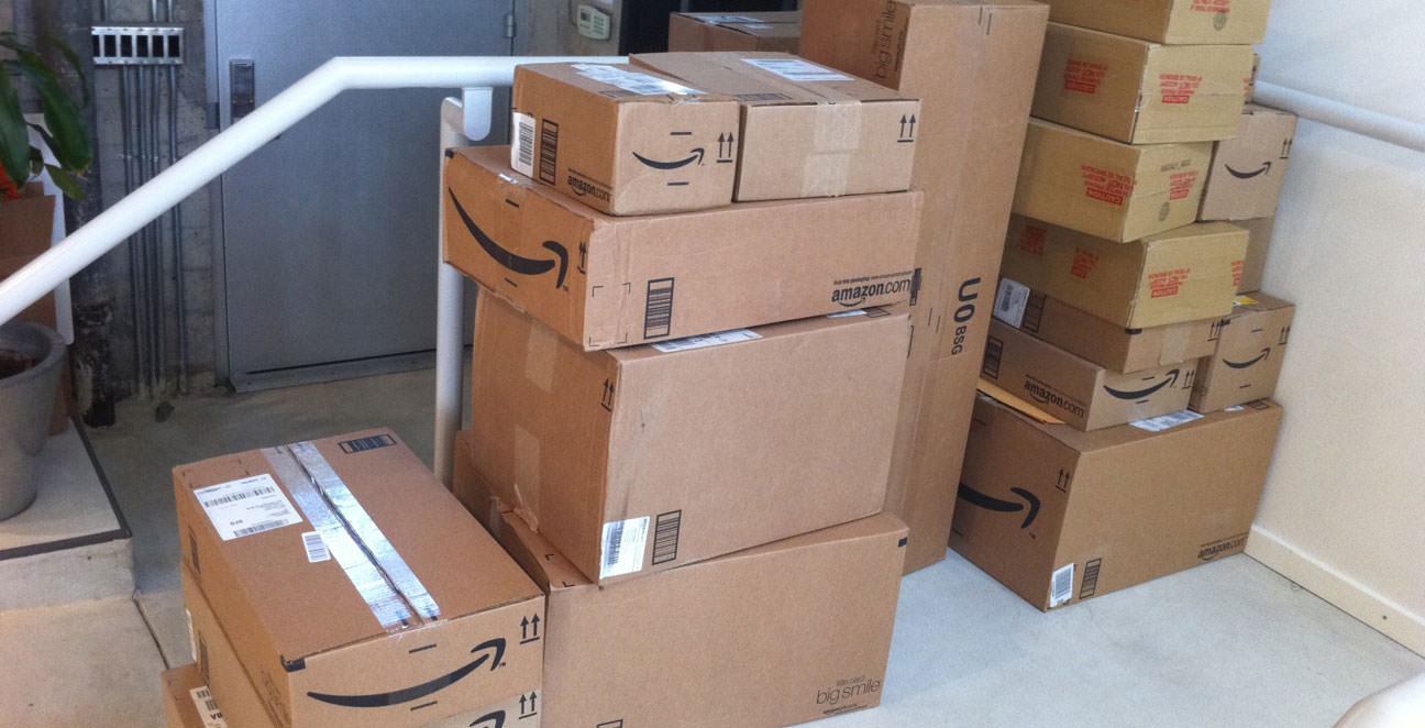 Stack of Amazon prime one-day shipping boxes