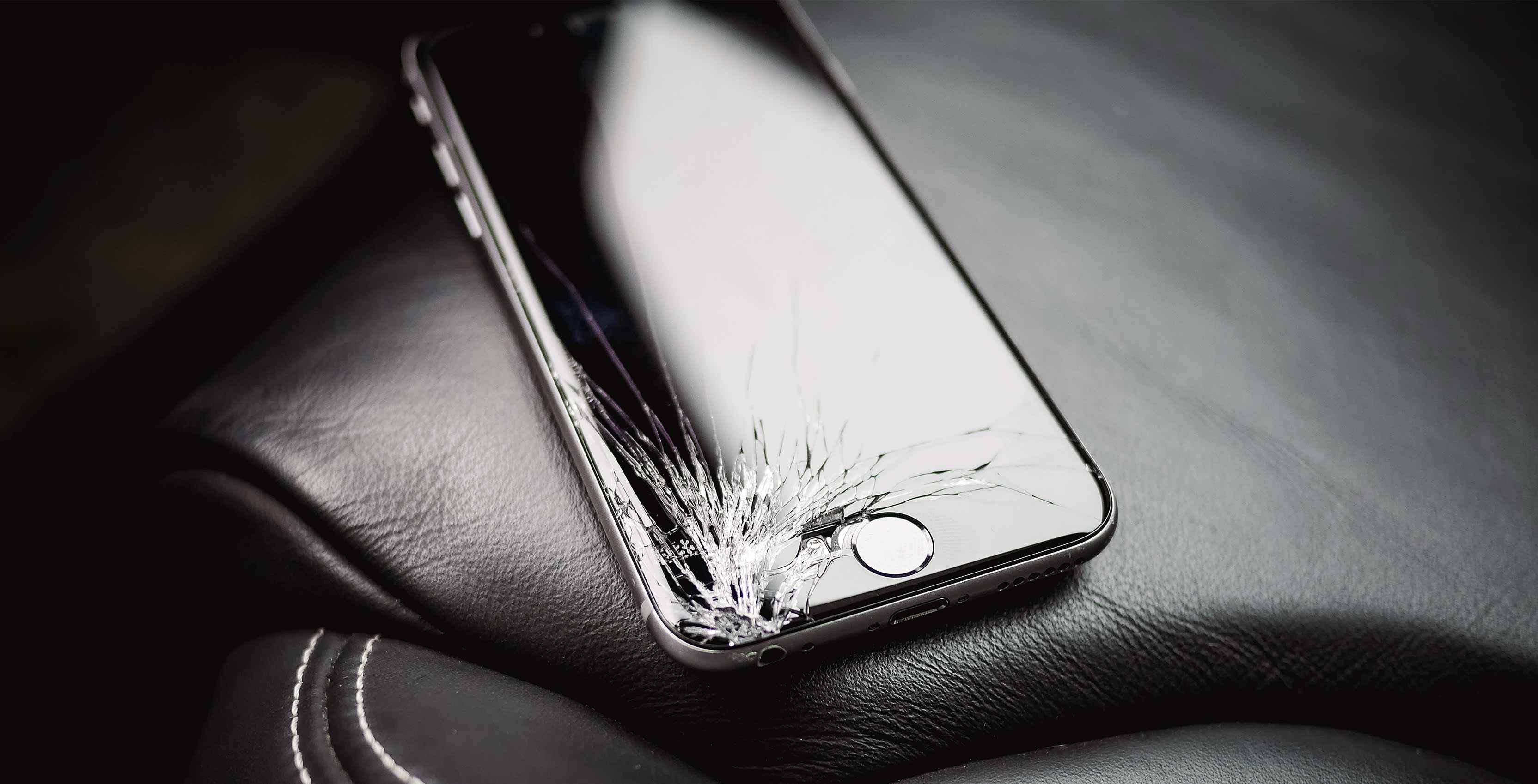 broken iphone on leather car seat - asurion