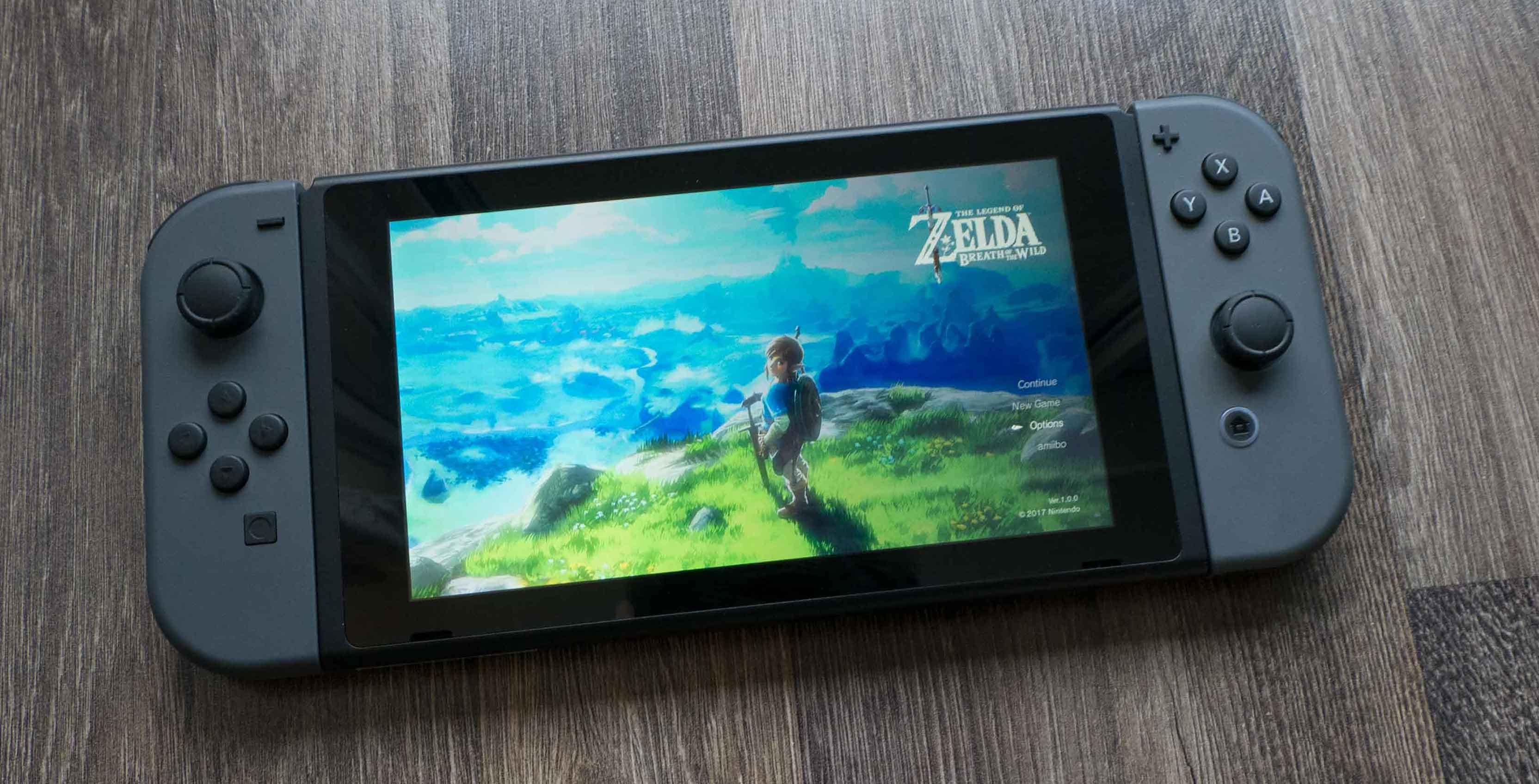 Nintendo Switch sitting on the ground with Joy-cons
