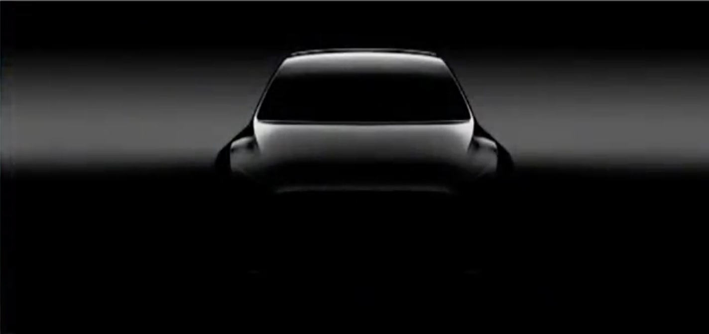 A shadowy image of Tesla's upcoming Model Y crossover SUV