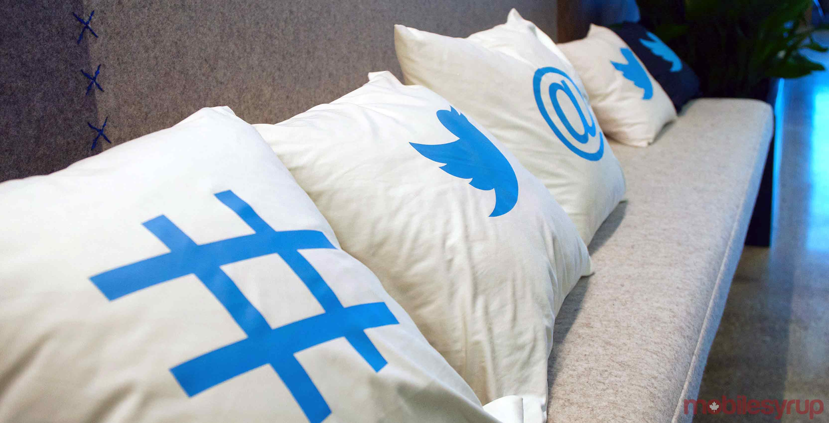 A collection of pillows featuring popular Twitter icons
