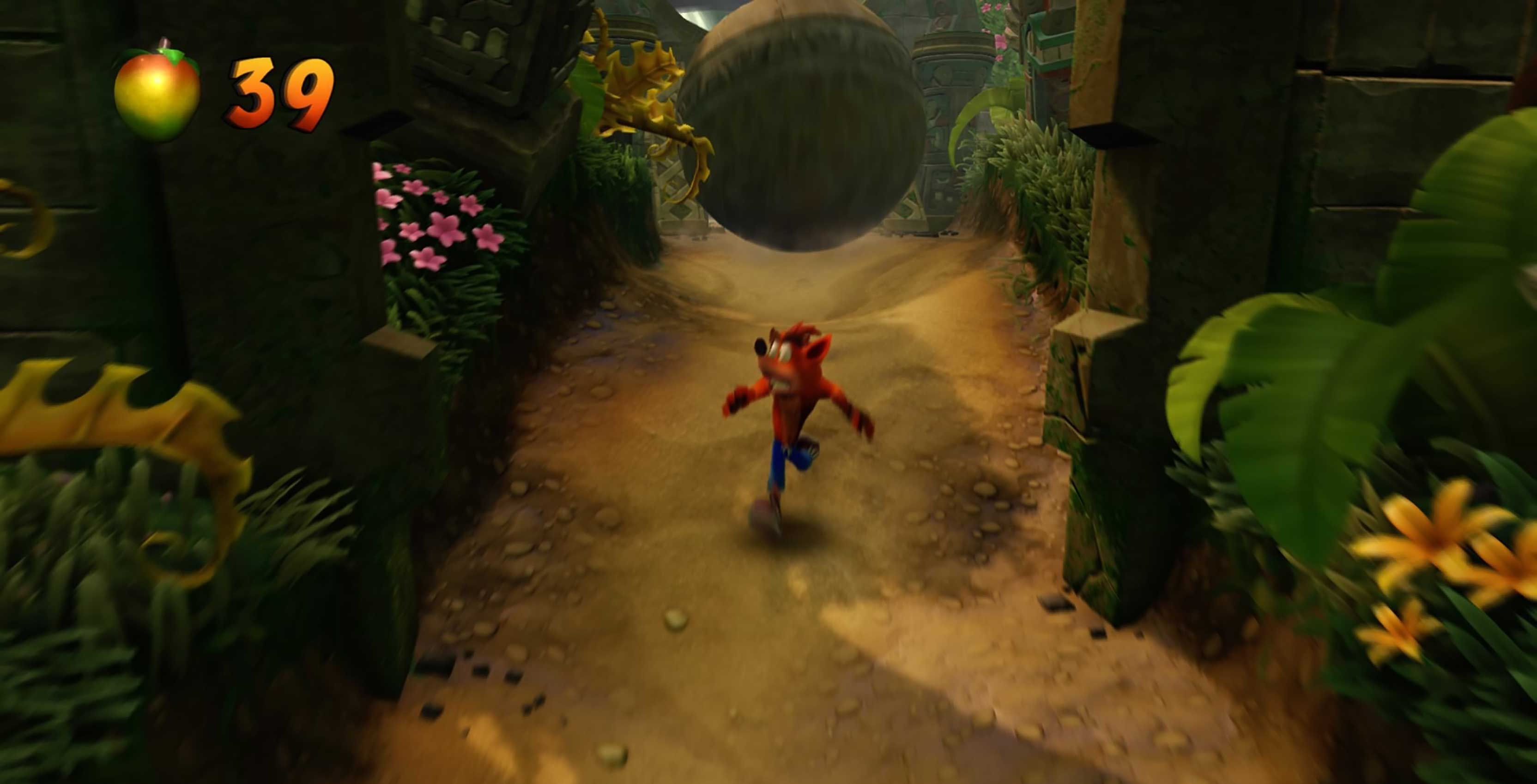 Crash Bandicoot running from boulder