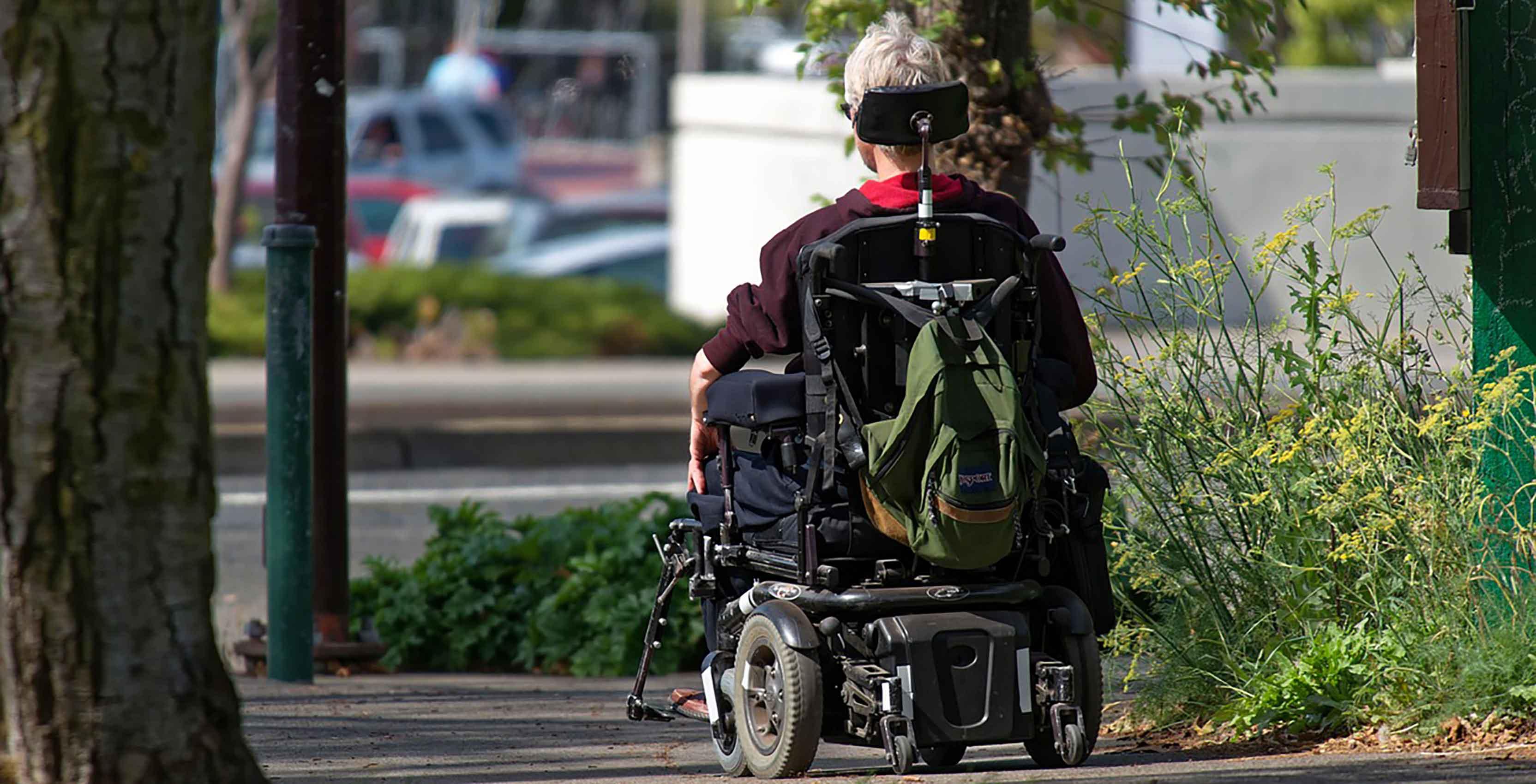 Man in motorized wheelchair