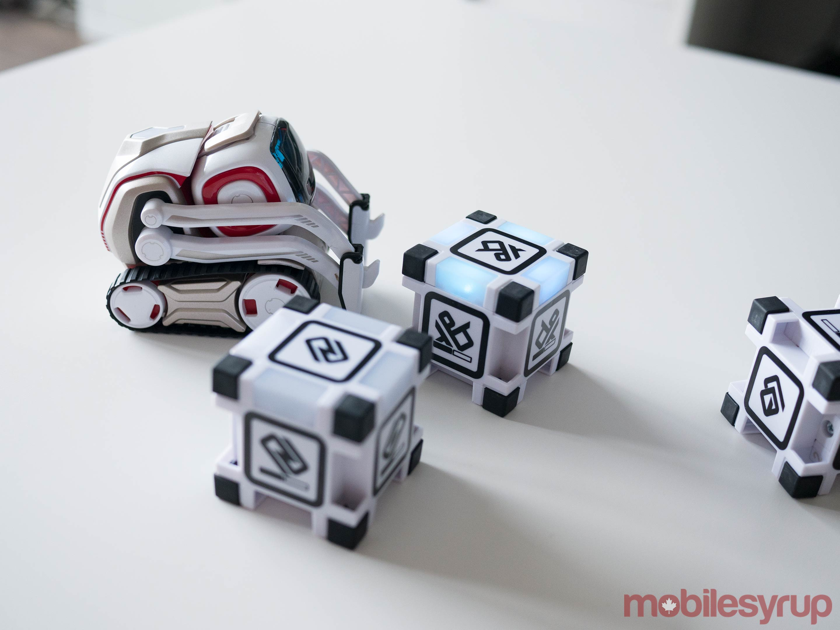 Cozmo playing with blocks