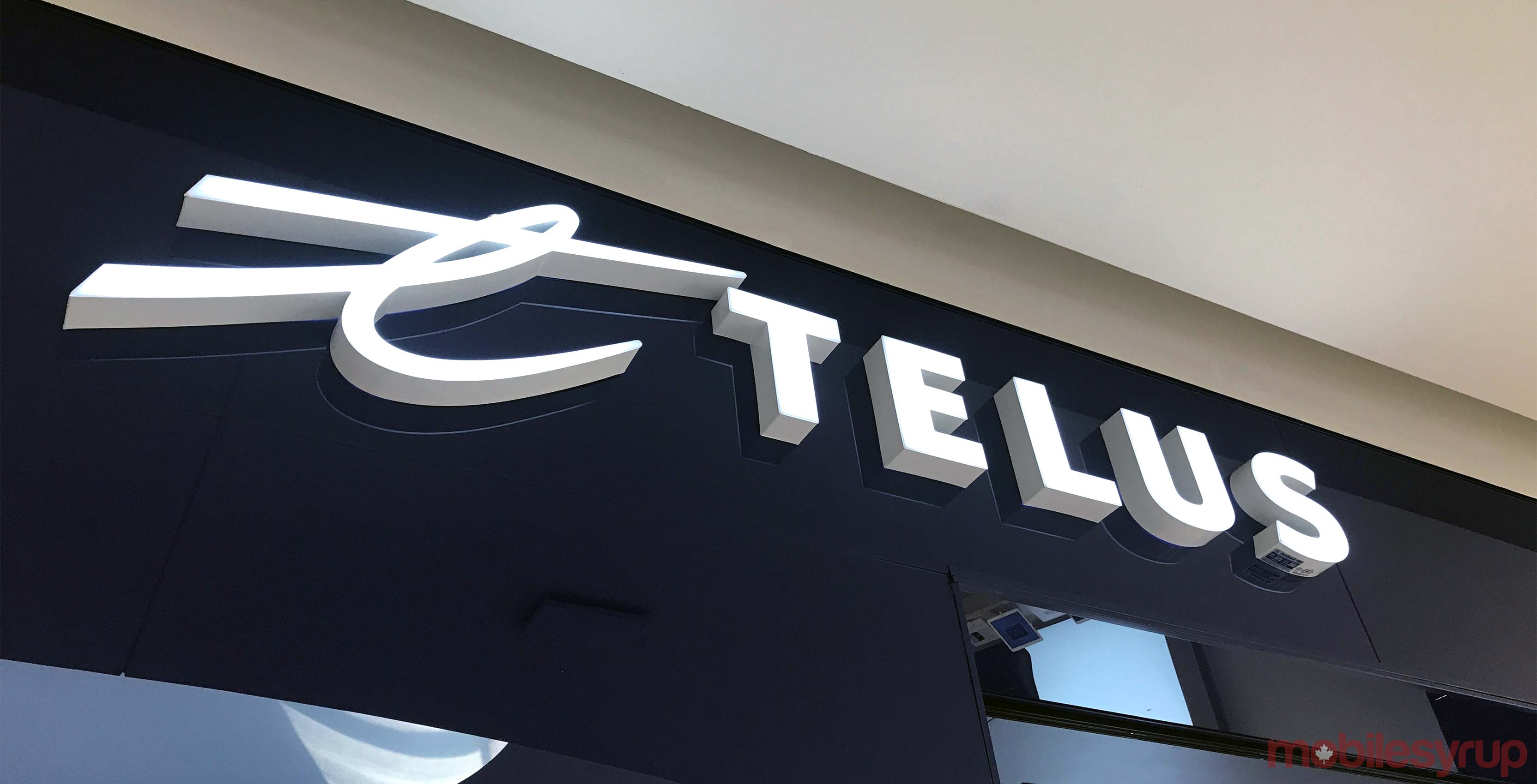 Telus logo on wall