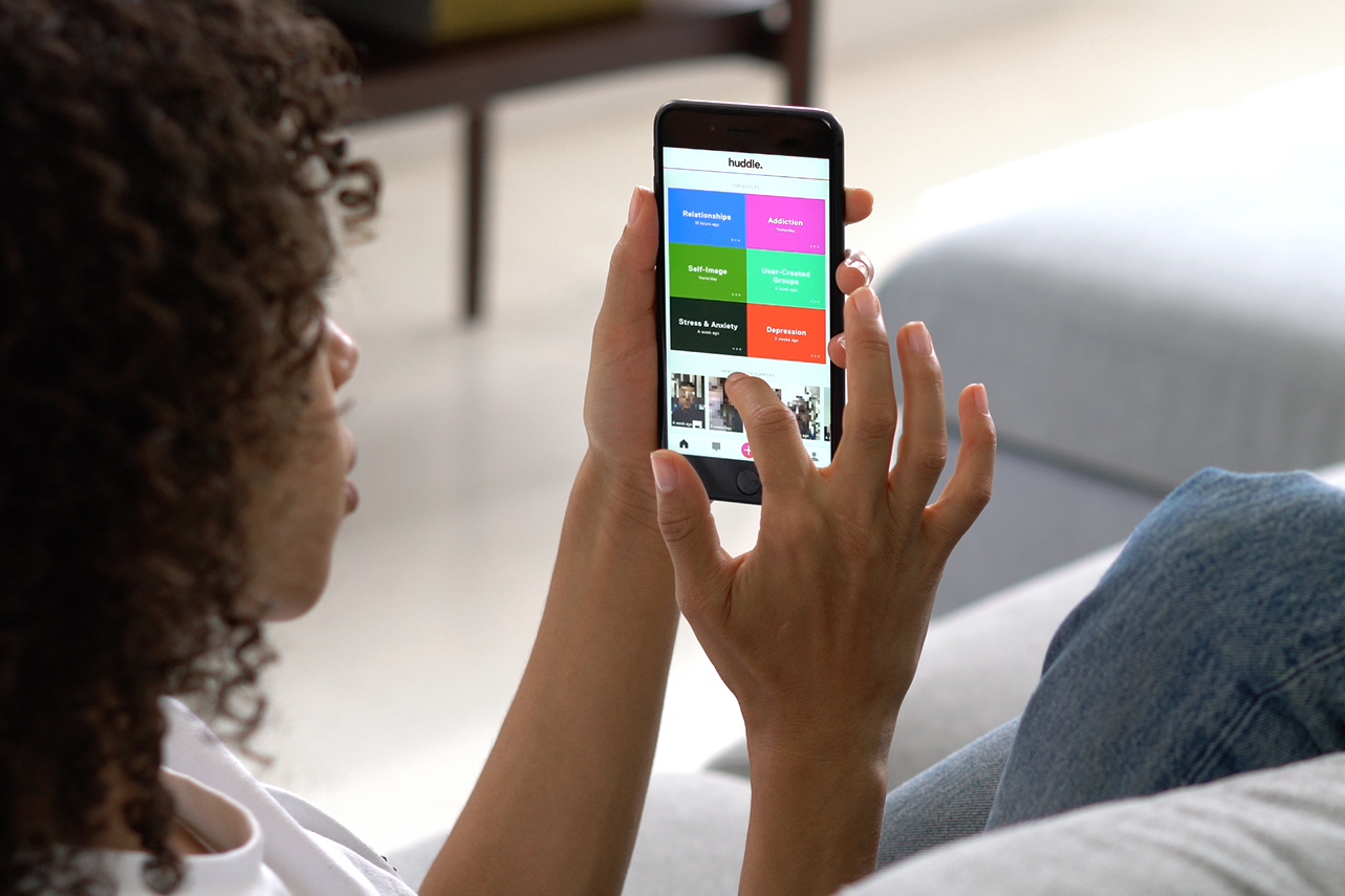An image showing a user browsing through different groups on the Huddle app