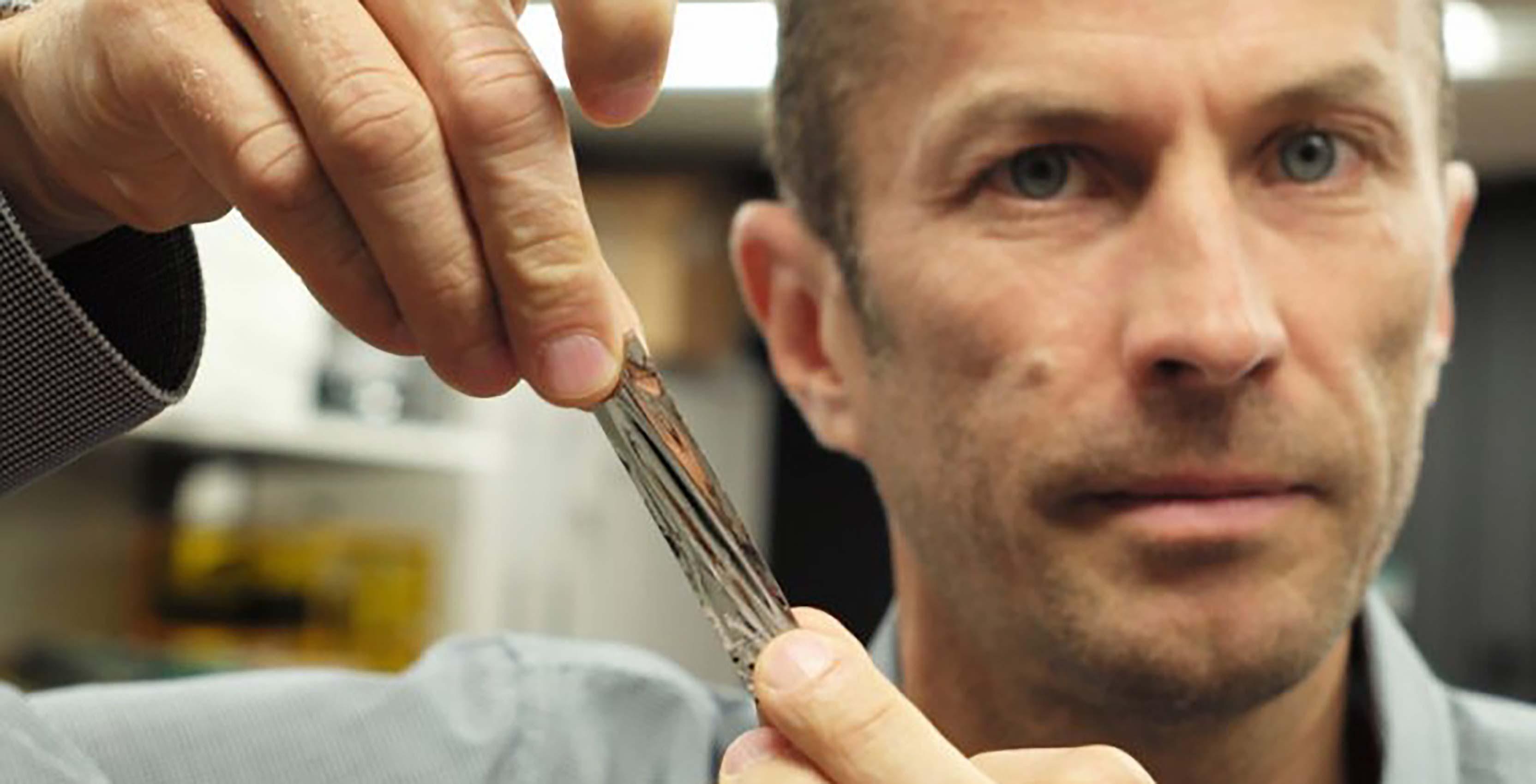 IBM scientist with storage tape