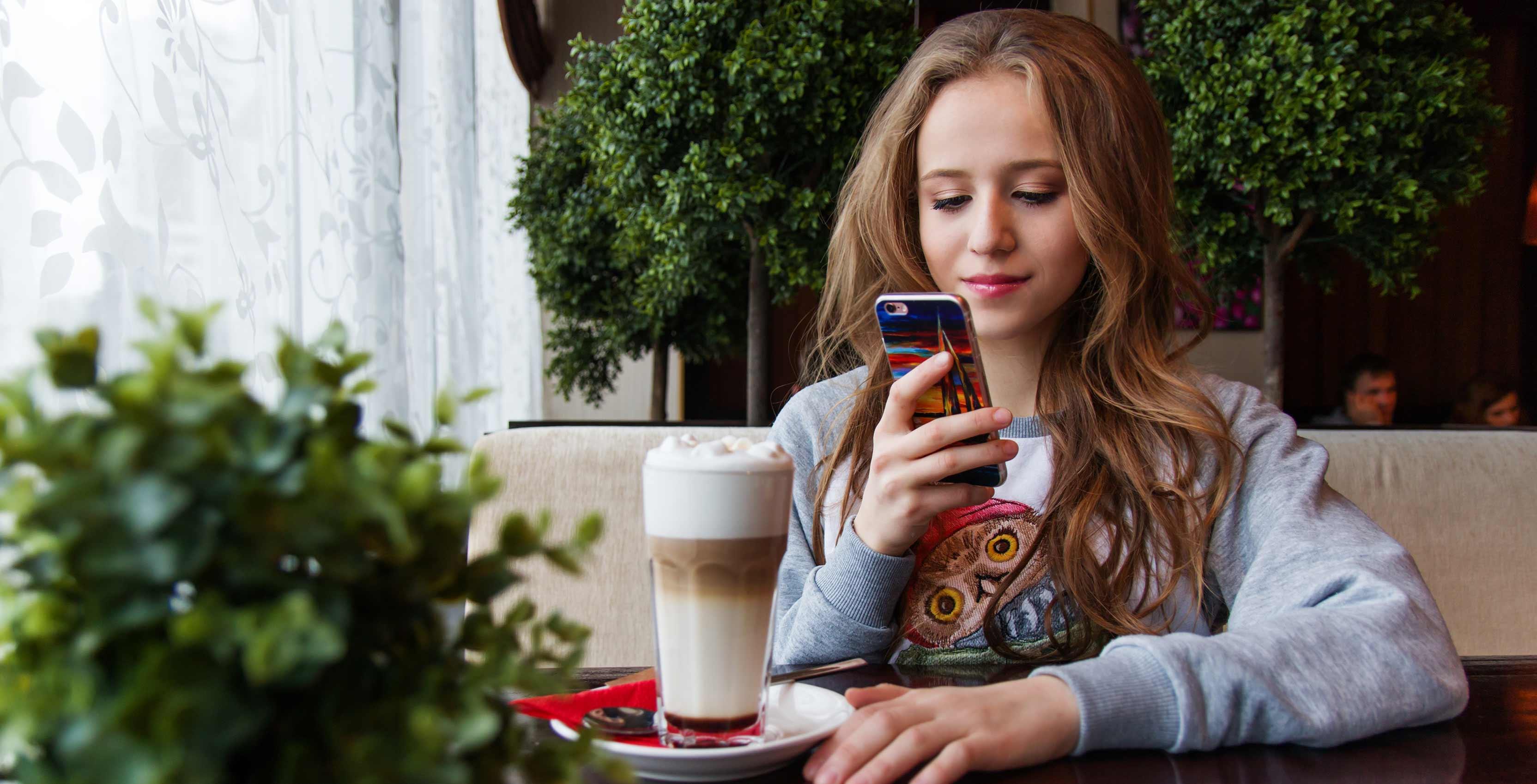 woman using phone in restaurant