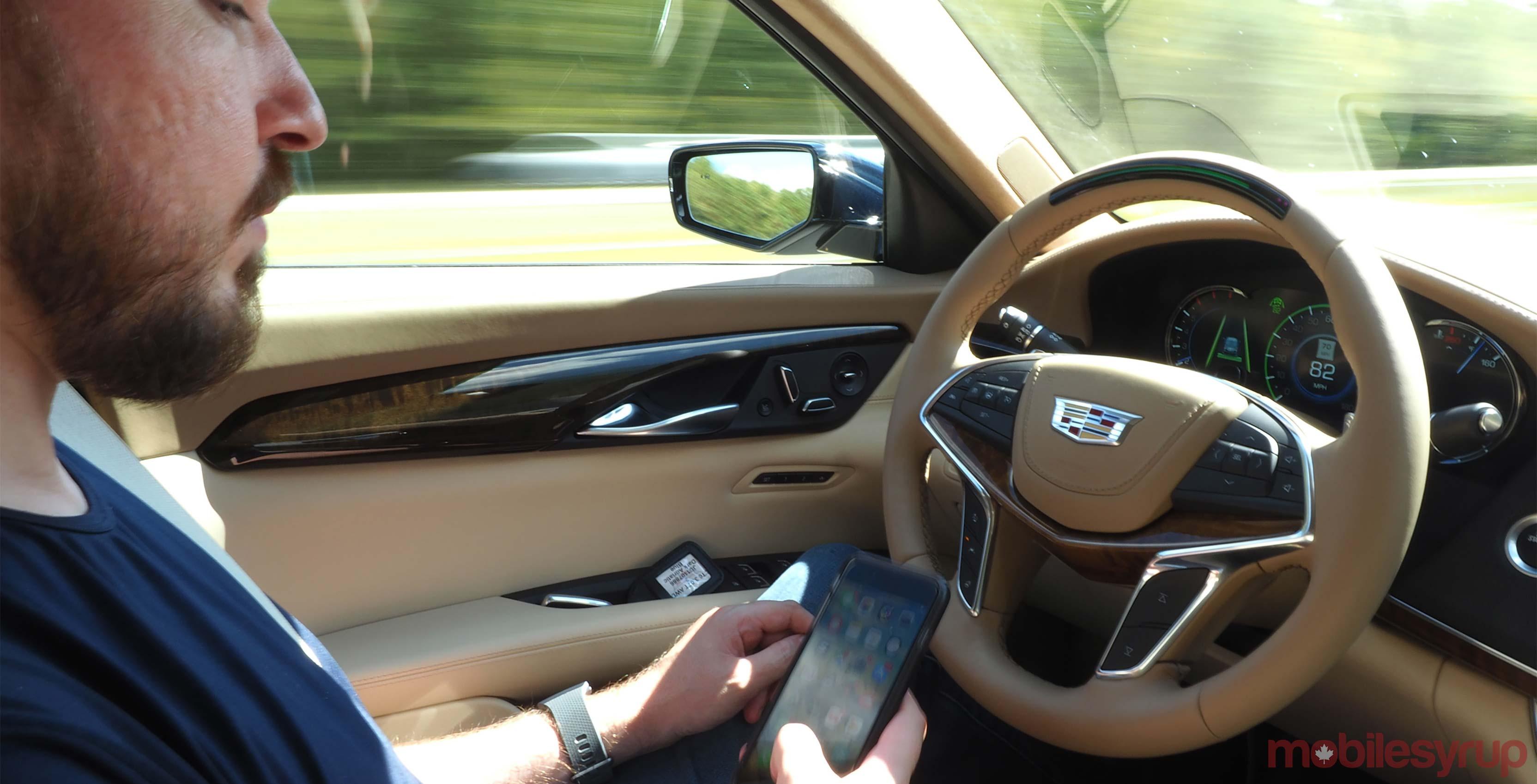 Cadillac CT6 Super Cruise holding phone