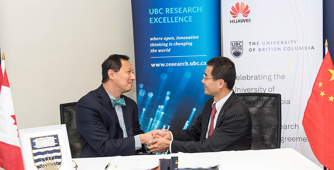 Huawei Canada president with president of UBC