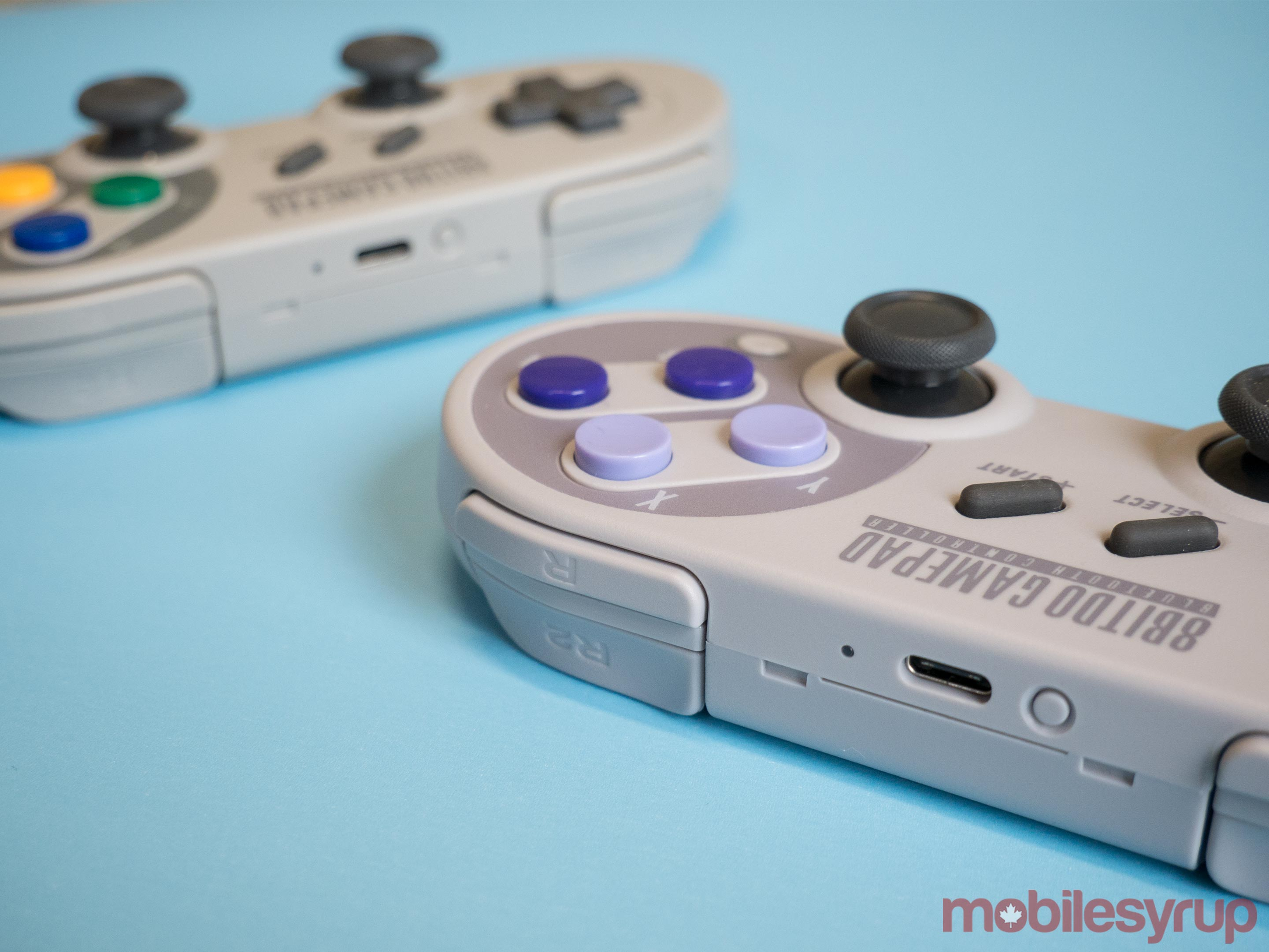 8bitdo's SN30 and SF30 Pro controller from a side view