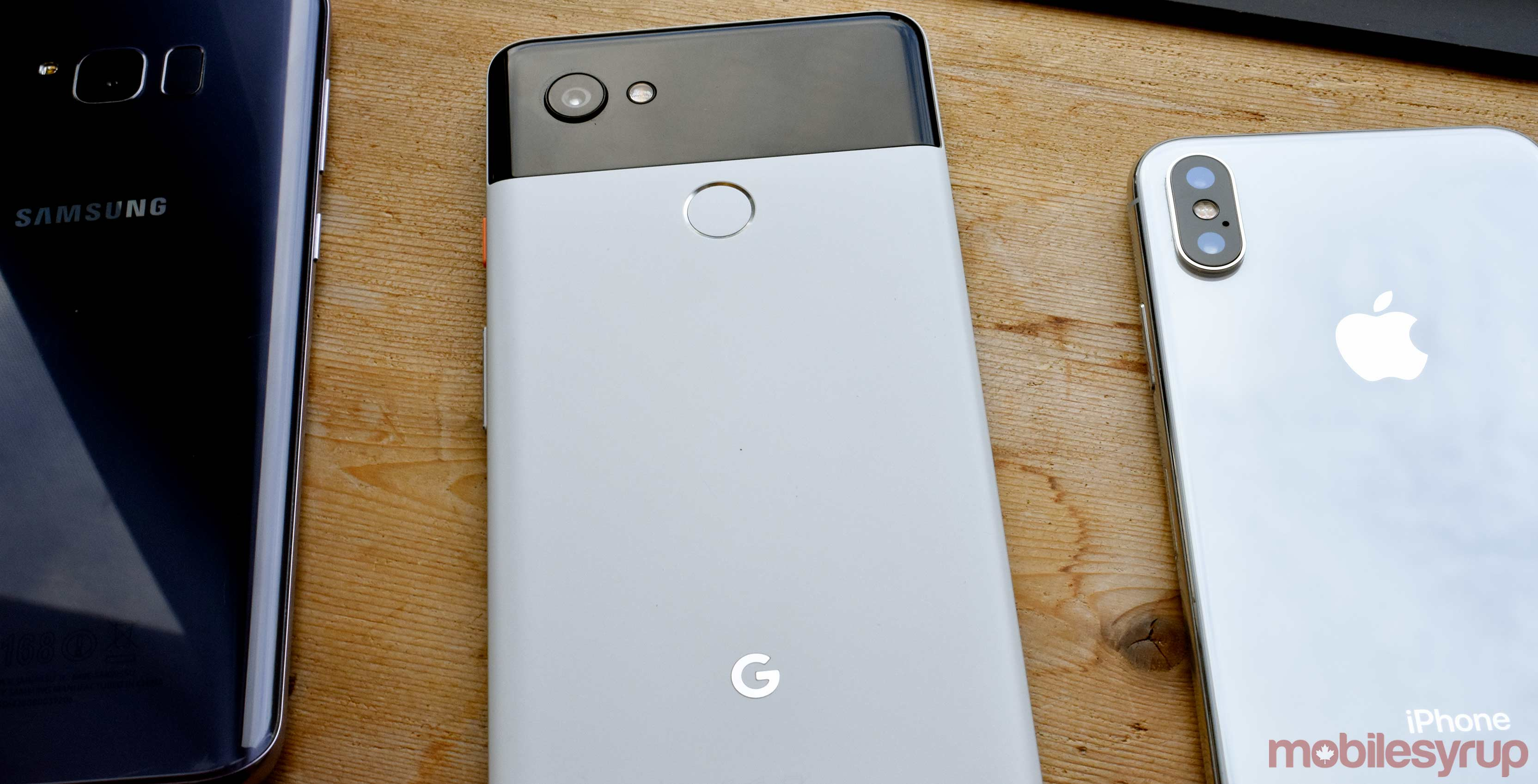 The Google Pixel 2 XL, Samsung S8 Plus and the iPhone X all beside one another