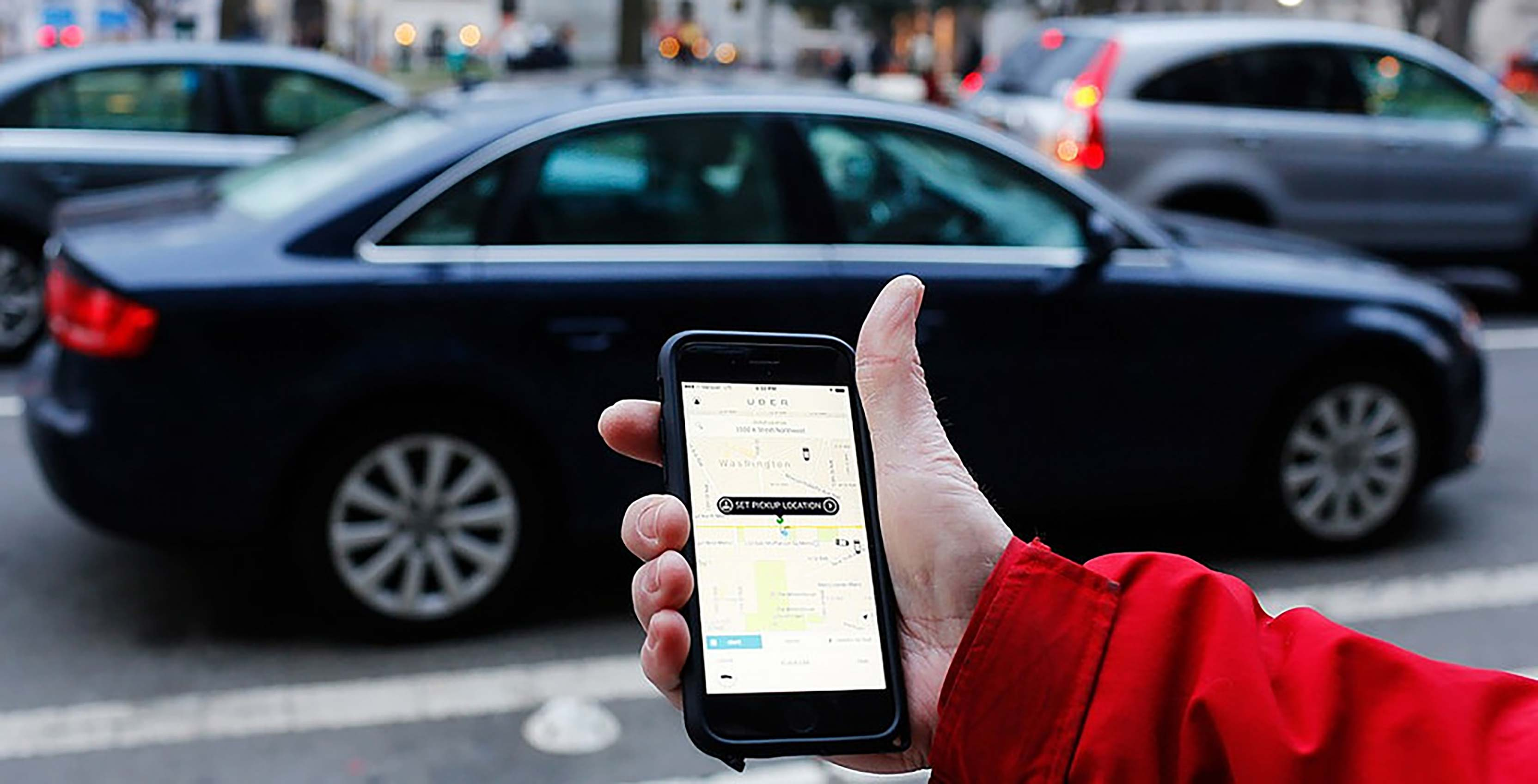Uber app on phone car pickup