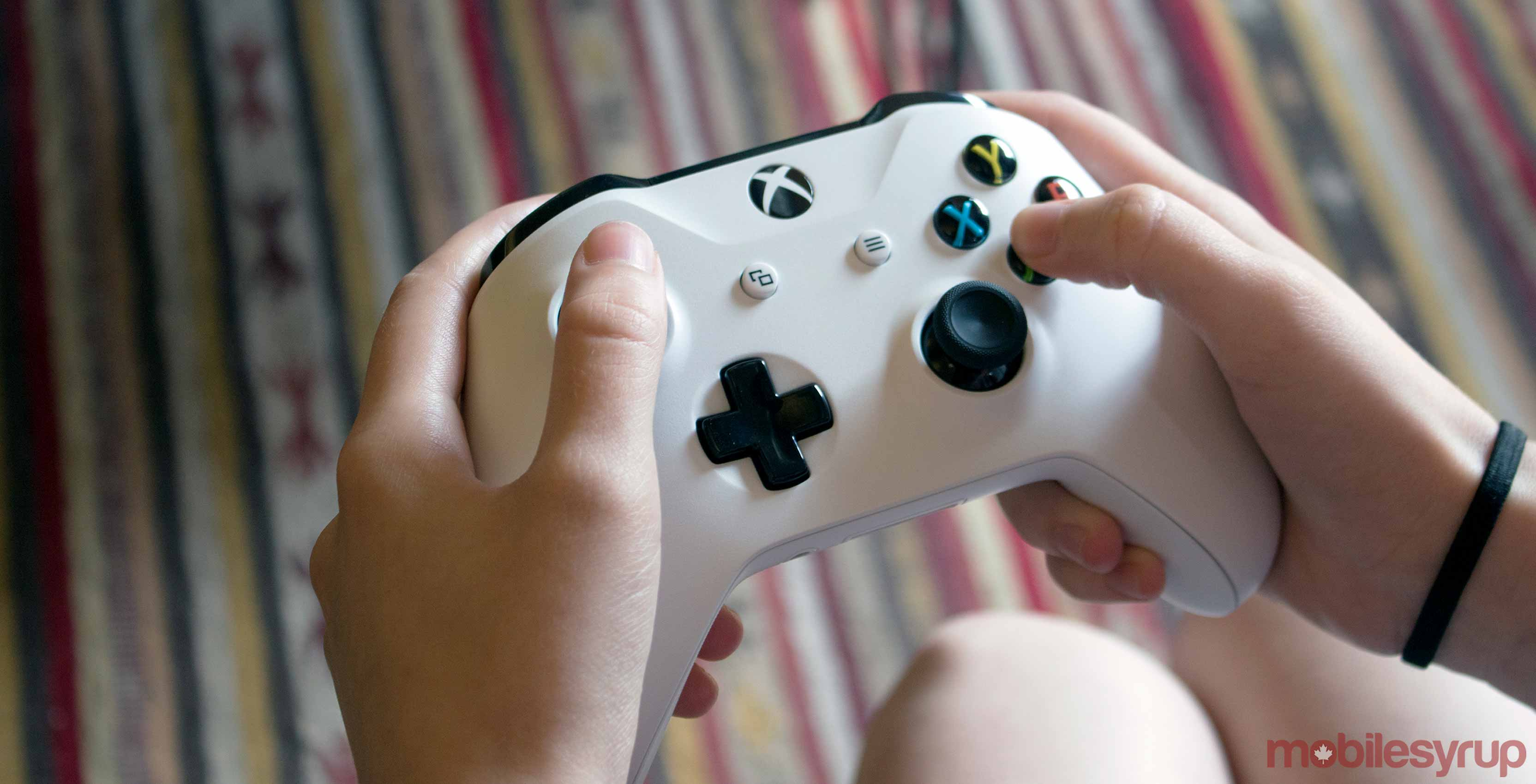 Xbox One white controller in hand