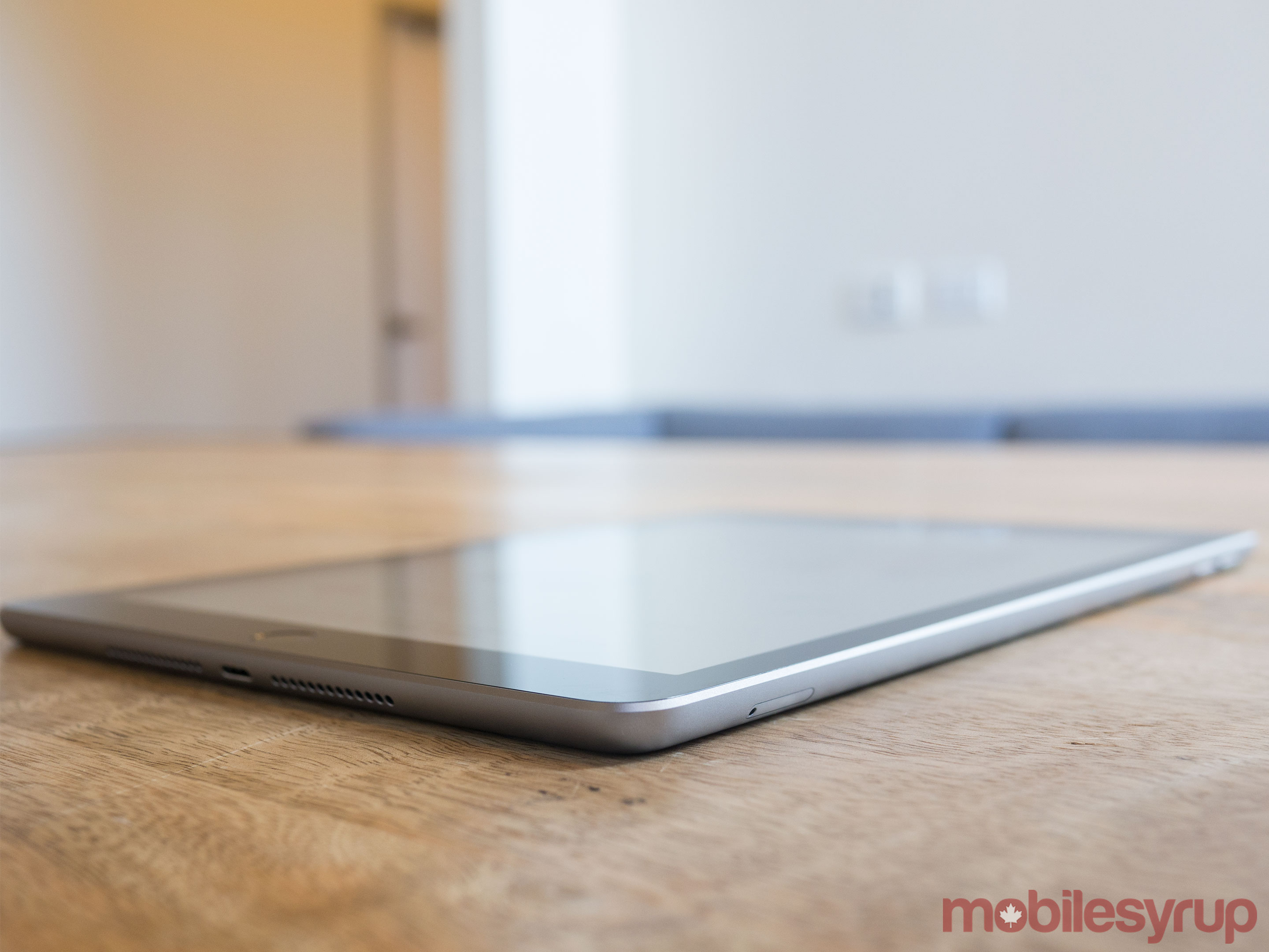 9.7-inch iPad side view on table