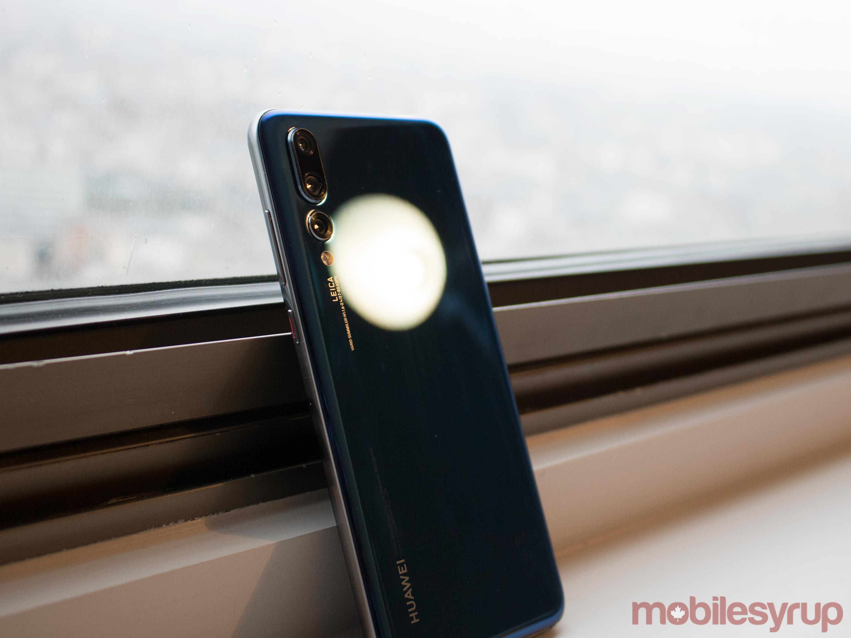 Huawei P20 Pro with light shining on rear