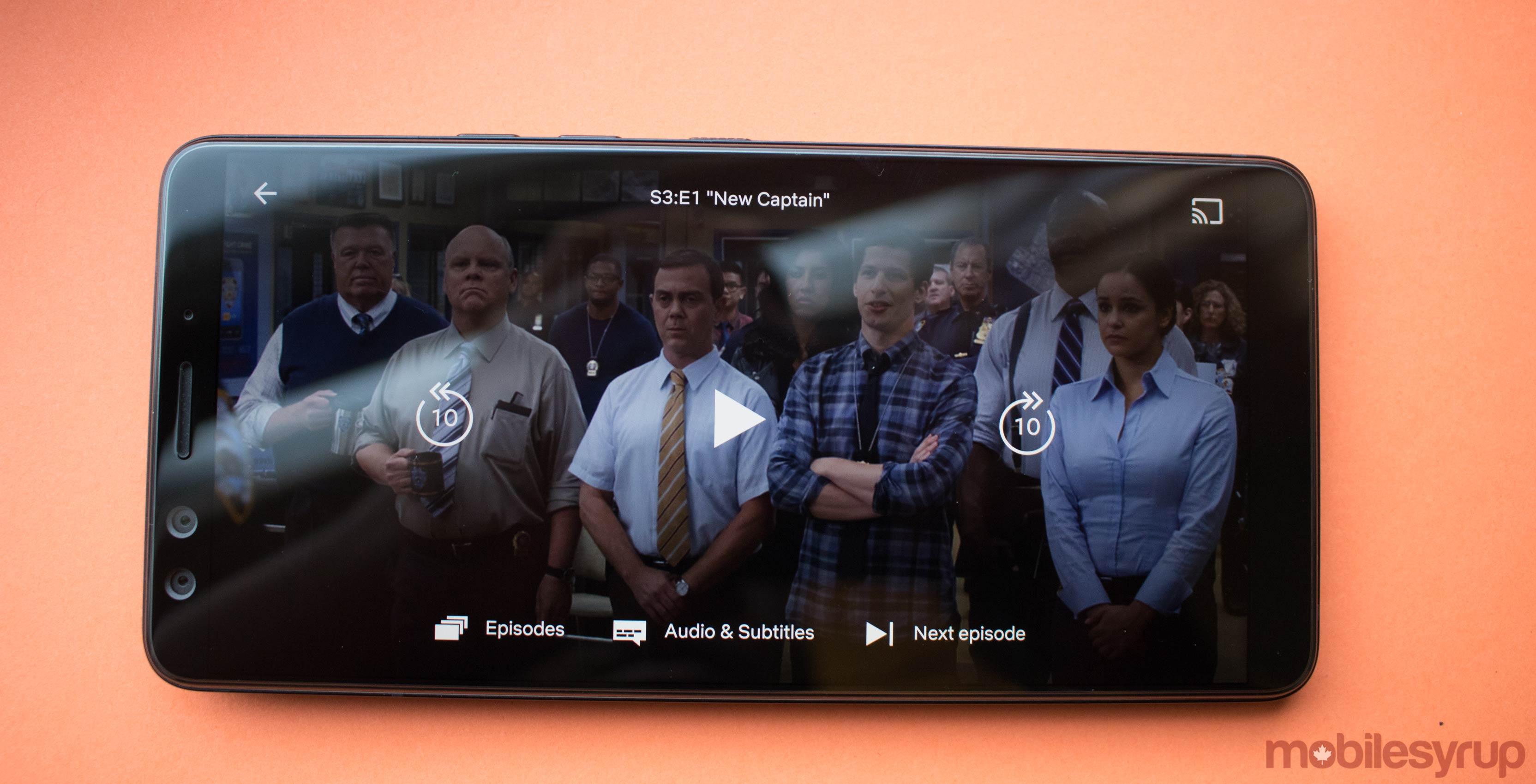 Netflix update button arrangement with Brooklyn Nine Nine in the background