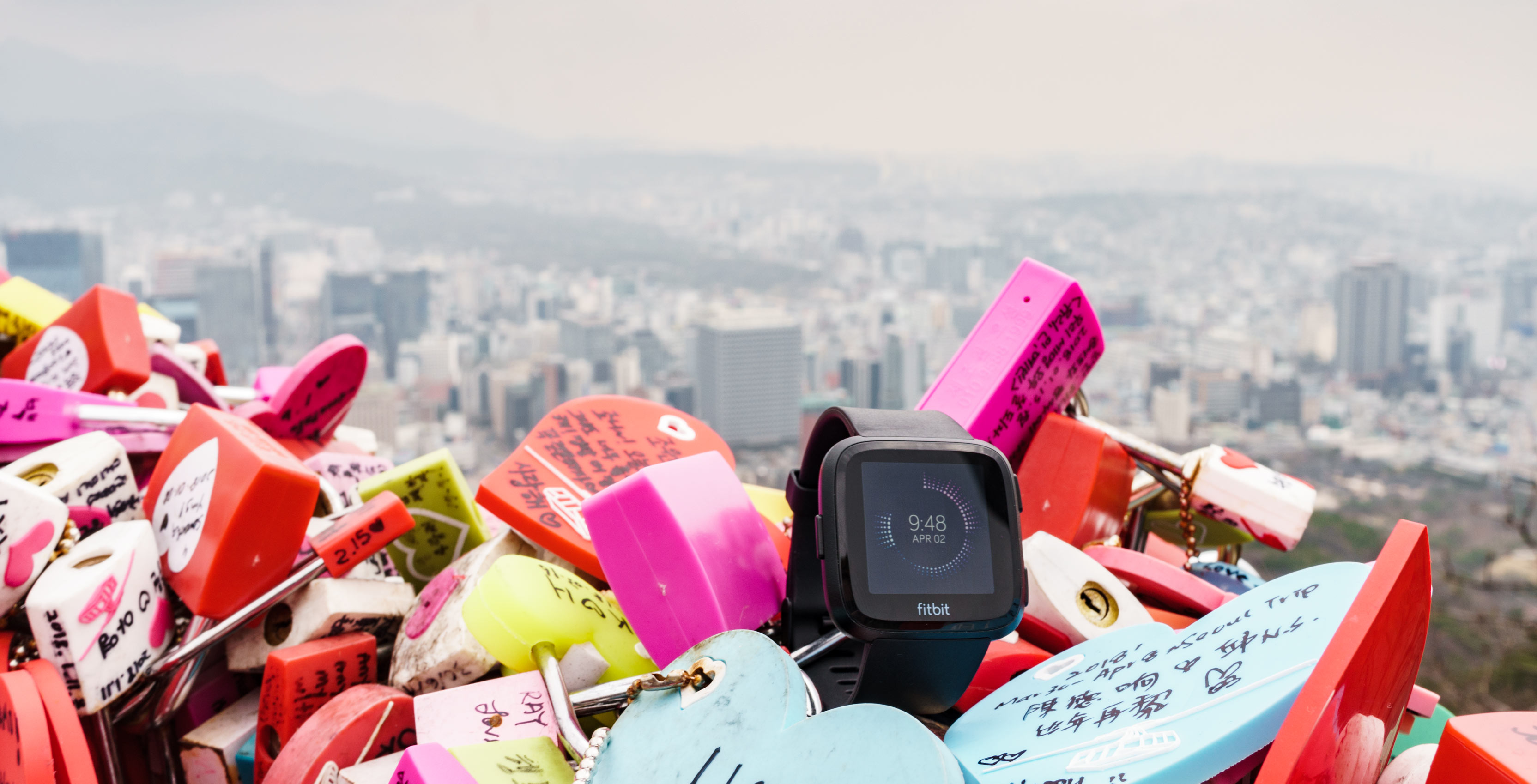 Fitbit Versa with city backdrop