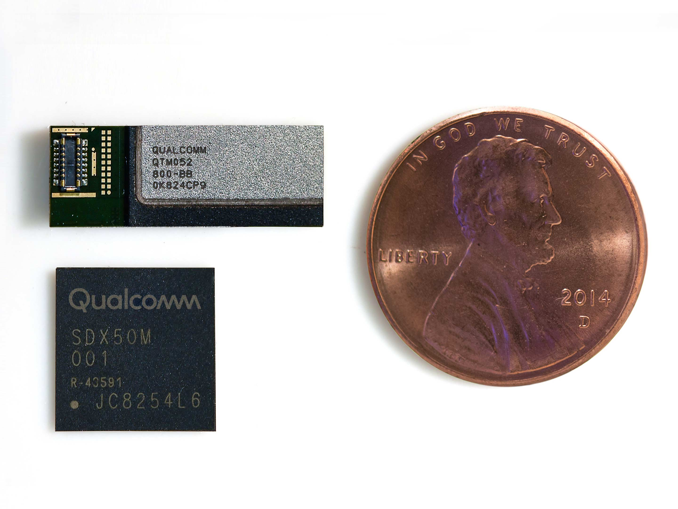 The size of the X50 modem and QTM052 antenna module compared to an American penny