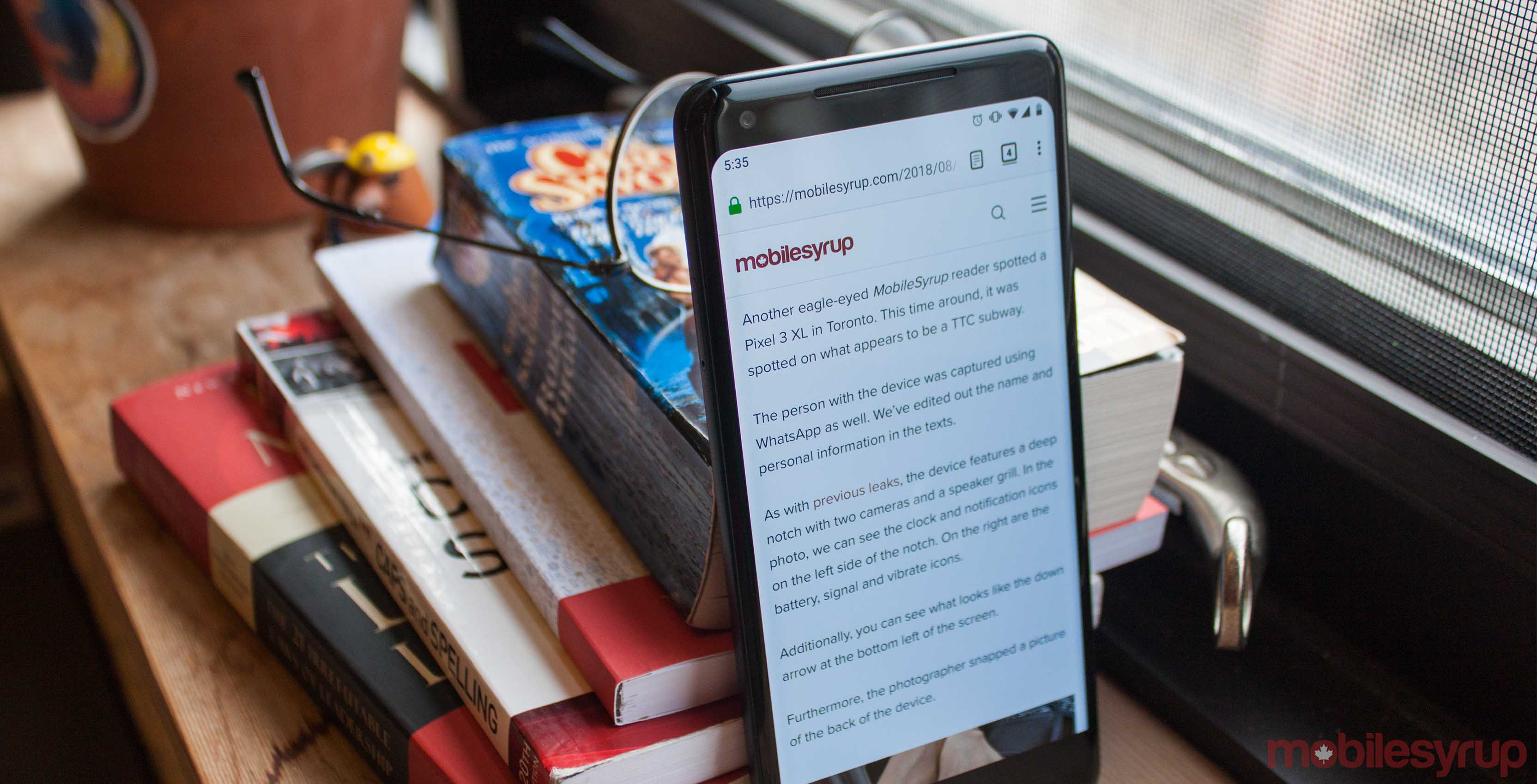 Pixel 2XL leaning against books