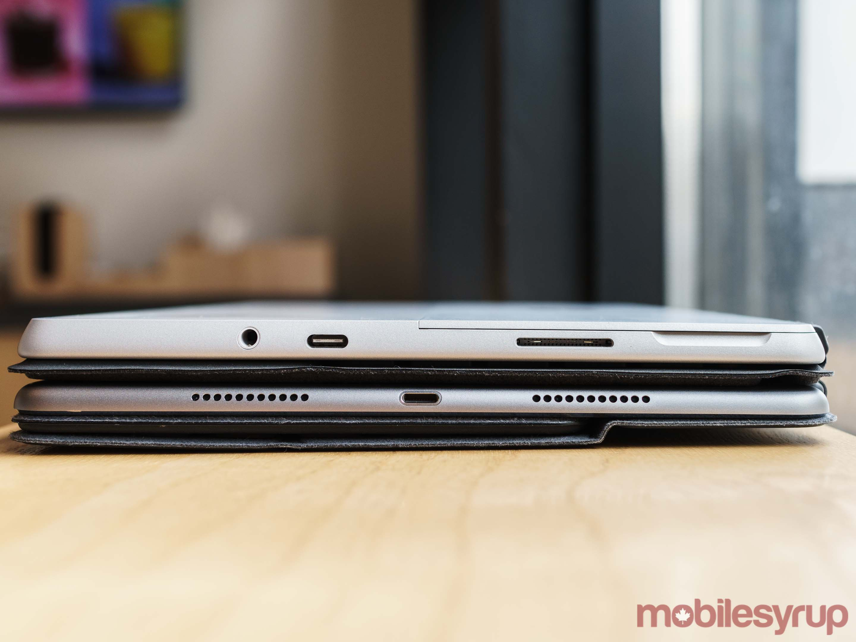 Surface Go stacked on top of the 10.5-inch iPad Pro