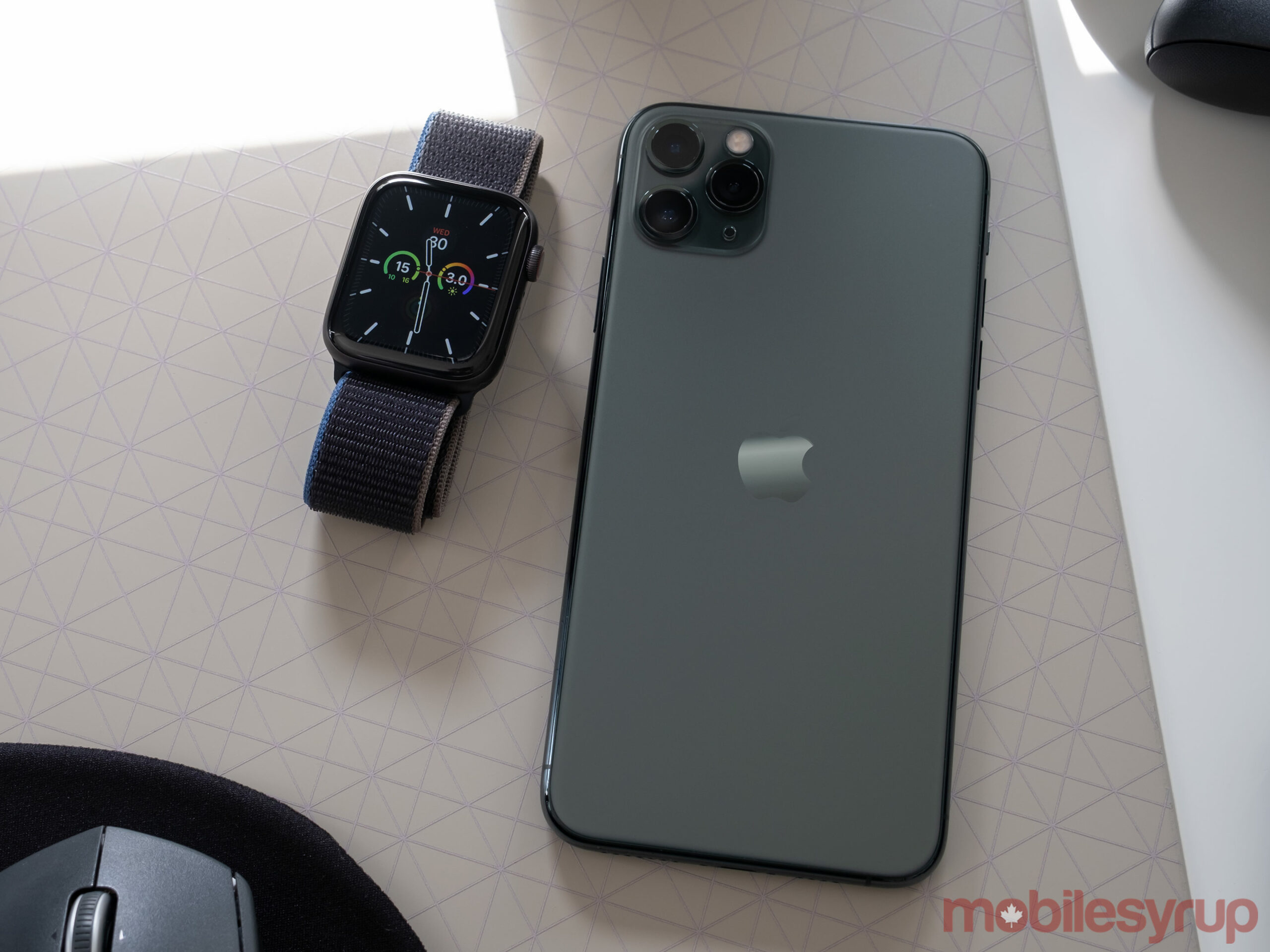 Apple Watch SE beside the iPhone 11 Pro Max