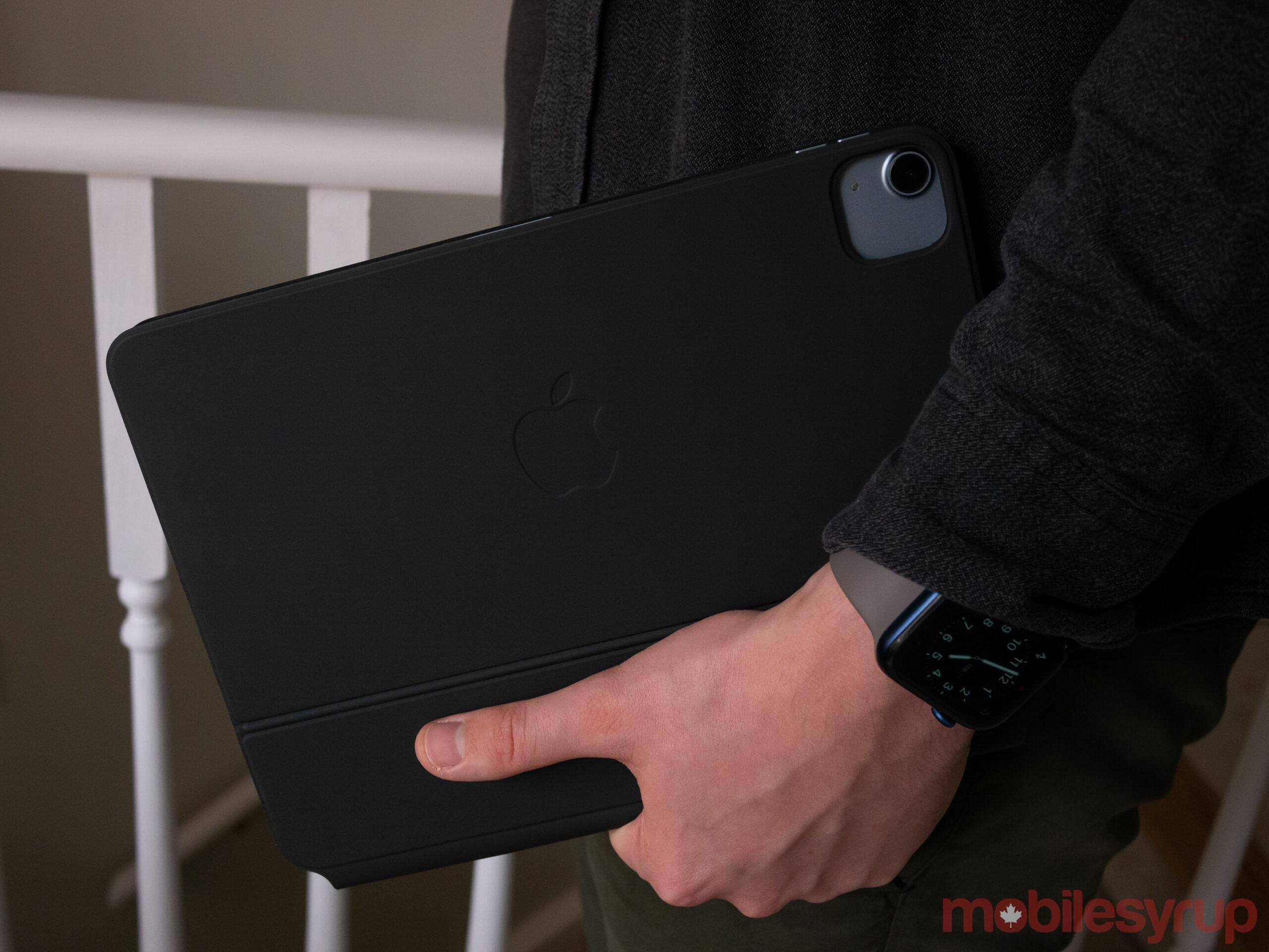 iPad Air in hand
