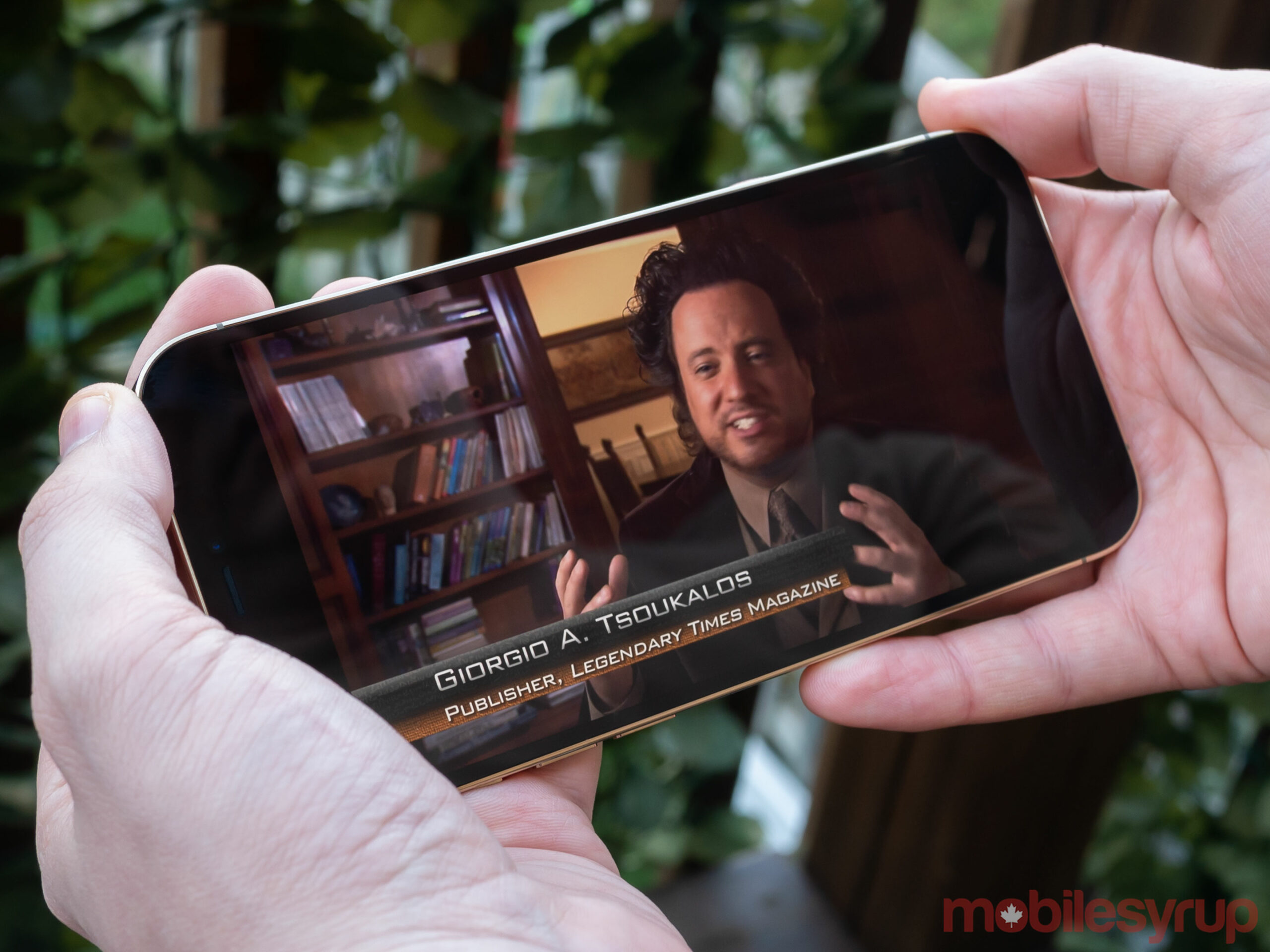 iPhone 12 Pro Max playing Ancient Aliens on Netflix