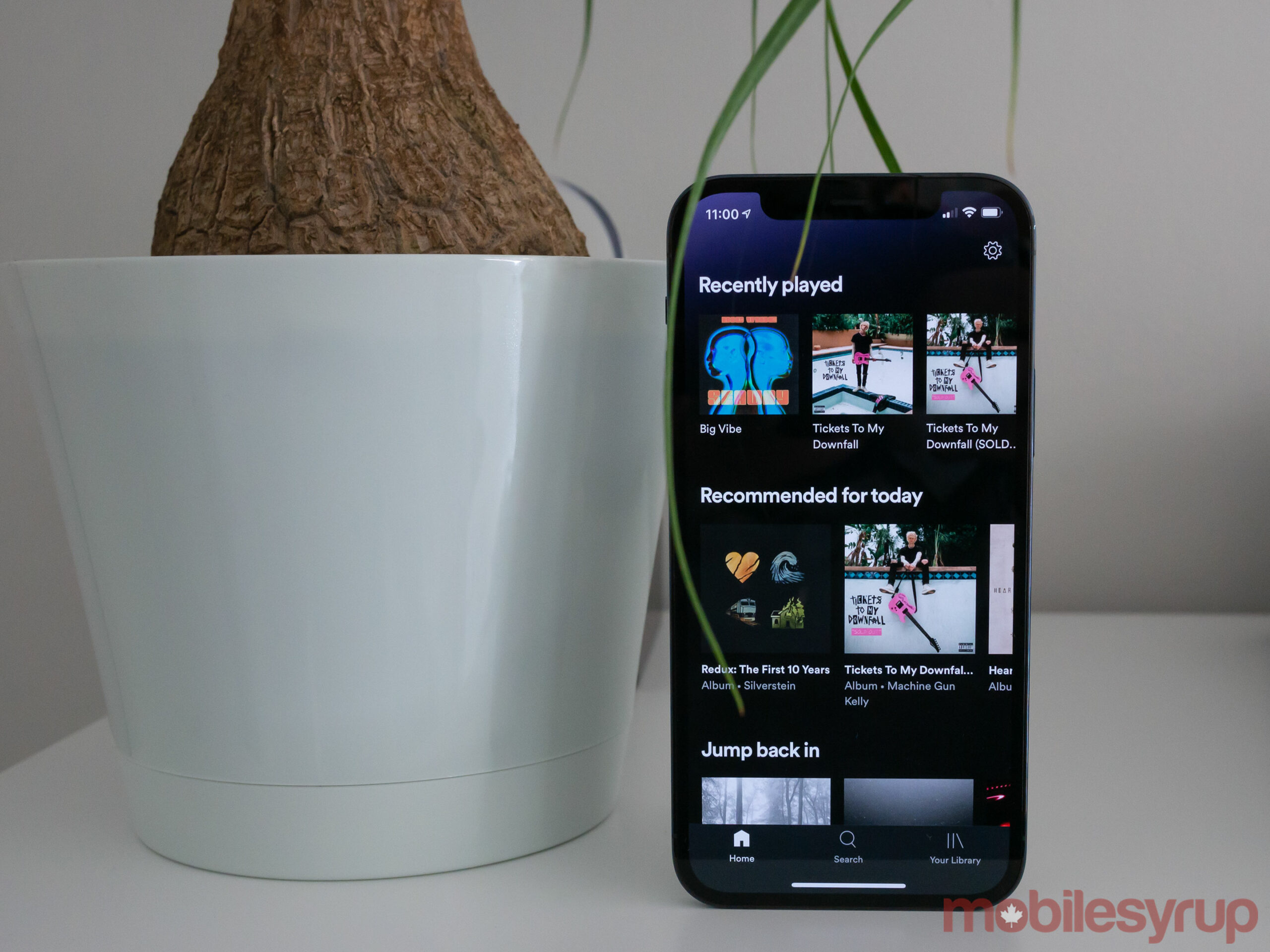 iPhone 12 Pro with Spotify open