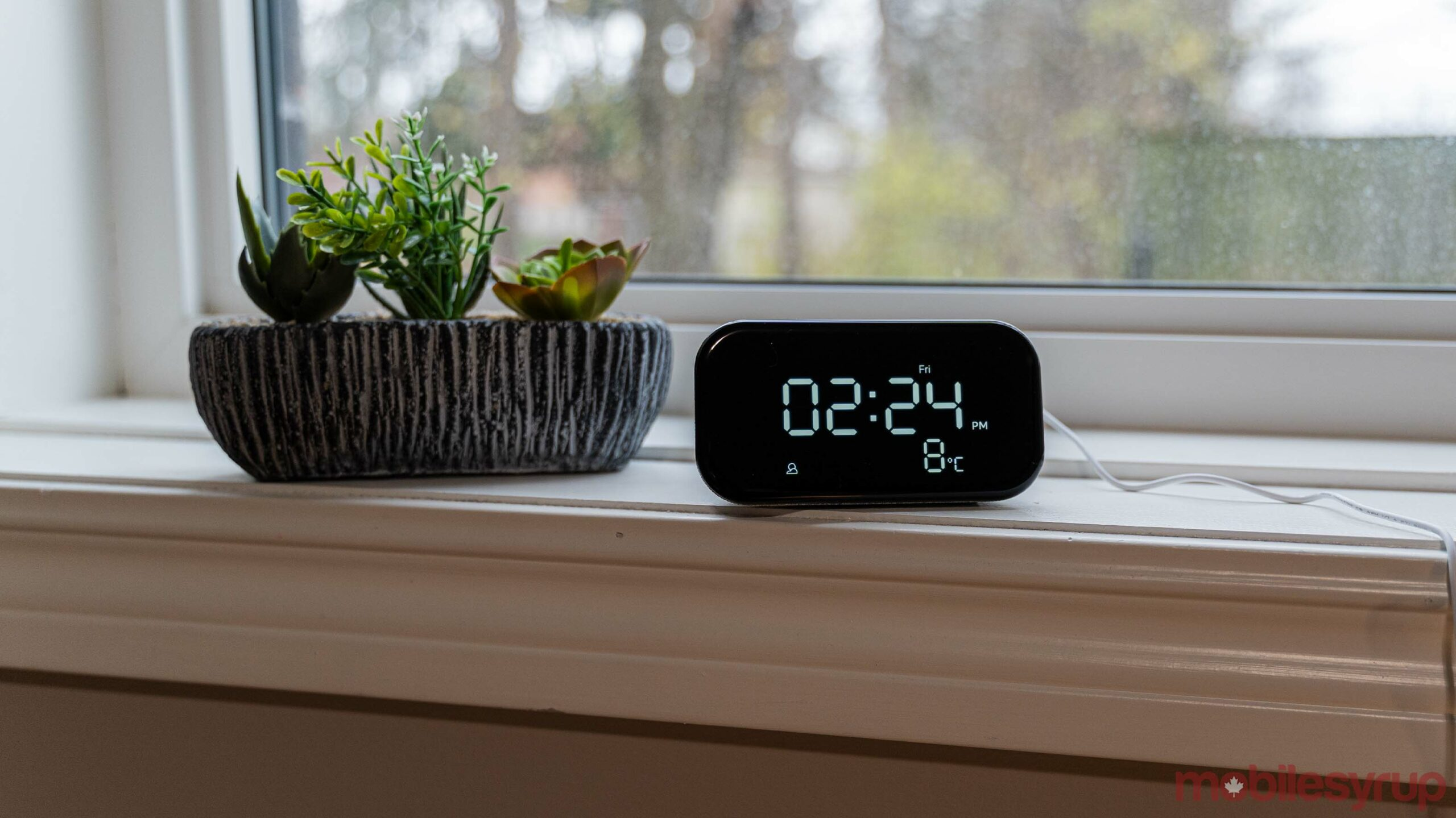 Lenovo Smart Clock Essential with a fake succulent